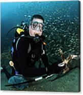 Diver Collects Invasive Lionfish Canvas Print
