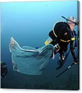 Diver Removes Invasive Indo-pacific Canvas Print