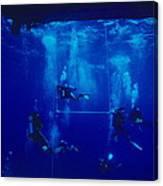 Divers Decompressing Beneath A Boat Canvas Print