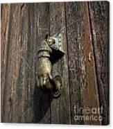 Door Handle In The Shape Of A Hand Canvas Print