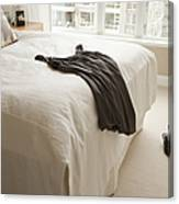 Dress Lying On Bed Canvas Print