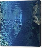 Dry Suit Divers Entering The Gin Clear Canvas Print