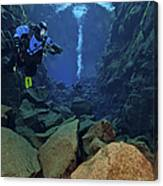 Dry Suit Divers In Gin Clear Waters Canvas Print