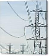 Electricity Pylons Against A Clear Blue Canvas Print