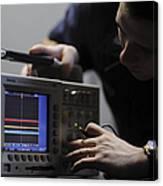 Electronics Technician Troubleshoots An Canvas Print