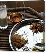 Enjoying A Plate Of Rajasthani Food On A Steel Plate On A Bamboo Table Canvas Print