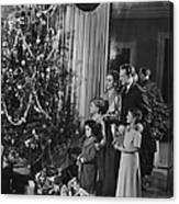 Family With Three Children (4-9) Standing At Christmas Tree, (b&w) Canvas Print