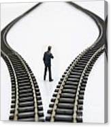 Figurine Between Two Tracks Leading Into Different Directions  Symbolic Image For Making Decisions Canvas Print