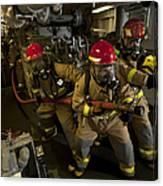 Firemen Combat A Simulated Fire Aboard Canvas Print