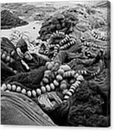 Fisherman Sleeping On A Huge Array Of Nets Canvas Print