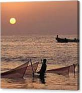 Fishermen Holding Nets In Sea At Sunset Canvas Print
