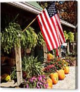 Flag Among The Pumpkins Canvas Print