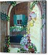 Flowers In Stone Doorway Canvas Print