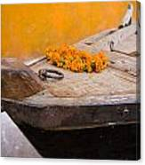 Flowers On Top Of Wooden Canoe Canvas Print