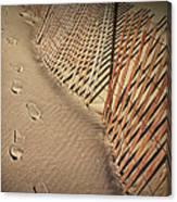 Footprints On The Beach Along A Fence Canvas Print