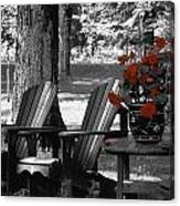 Garden Chairs With Red Flowers In A Pot Canvas Print