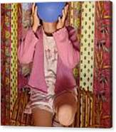 Girl Blowing Up Balloon Canvas Print
