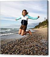 Girl Jumping At Lake Superior Shore Canvas Print
