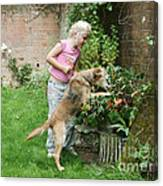Girl Playing With Dog Canvas Print