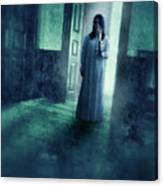 Girl With Candle In Doorway Canvas Print