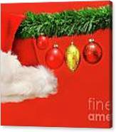 Green Garland With Santa Hat And Ornaments Canvas Print