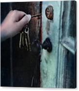 Hand Putting Vintage Key Into Lock Canvas Print