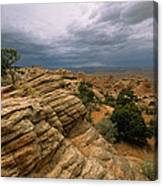 Heavy Clouds Over A Rocky Desert Canvas Print