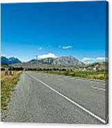 Highway Towards Panoramic Mountain Canvas Print
