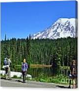 Hikers At Reflection Lake Canvas Print