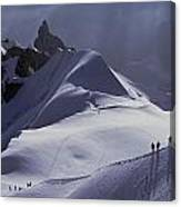 Hikers Follow Paths Across The Snow Canvas Print