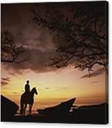 Horseback Rider Silhouetted On A Beach Canvas Print