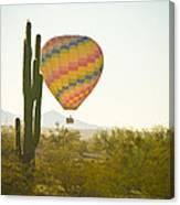 Hot Air Balloon Over The Arizona Desert With Giant Saguaro Cactu Canvas Print