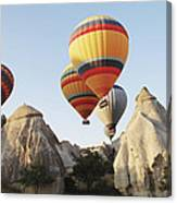 Hot Balloons Over Peaks Canvas Print