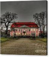House Illuminated And With Trees Branches Canvas Print