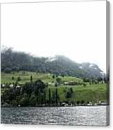 Houses On The Greenery Of The Slope Of A Mountain Next To Lake Lucerne Canvas Print