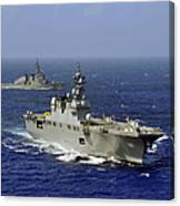 Jds Hyuga Sails In Formation With U.s Canvas Print