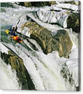 Kayaker At The Top Of A Waterfall Canvas Print