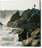 Kayaker Carries Boat Up The Rocks Canvas Print