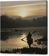 Kayakers Paddle Through Still Water Canvas Print
