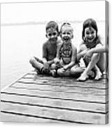 Kids Sitting On Dock Canvas Print