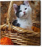 Kitten In Basket With Orange Yarn Canvas Print