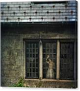 Lady By Window Of Tudor Mansion Canvas Print