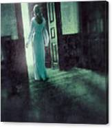 Lady In White Gown Walking Through A Mysterious Doorway Canvas Print