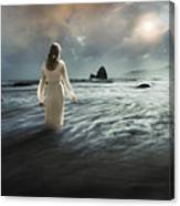 Lady Wading Into The Sea In The Early Morning Canvas Print