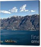 lake with Brissago islands and snow-capped mountain Canvas Print
