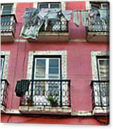 Laundry And A Pink Building  Lisbon Canvas Print