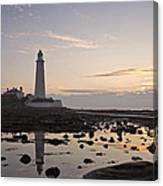 Lighthouse At Low Tide Canvas Print