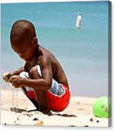 Little Boy Playing With Sand On The Beach Canvas Print