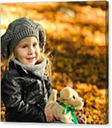 Little Girl In Autumn Leaves Canvas Print