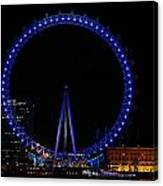 London Eye All Done Up In Blue Light In The Night With A Small Reflection In The Thames Canvas Print